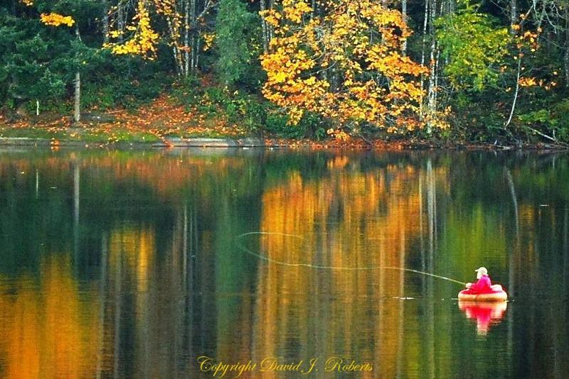 Caught in flight - fly fisherman at Lake Padden, Bellingham, WA