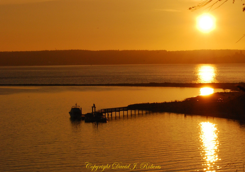 Sunset glow over Fort Flagler dock near Port Townsend Washington