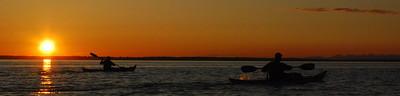 Kayakers in the sunset, Bellingham Bay, Washington - panorama