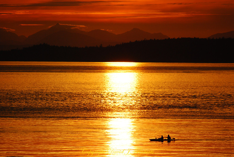 Sunset and kayakers from San Juan County Park, San Juan Island, Washington