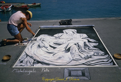 Chalk artist on waterfront sidewalk in Lucern Switzerland