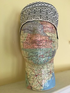 I glued a map of the USA onto this face and topped it off with a traditional cap (kuba) from Oman in celebration of my Omani friend Hassan's first visit to the USA.