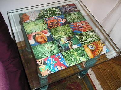 End table photos - a small checkerboard of greenery interspersed with close-ups of murals in San Francisco's Mission District.