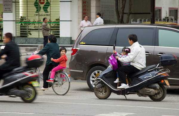 Fathers taking their children home from school in Yangshou.