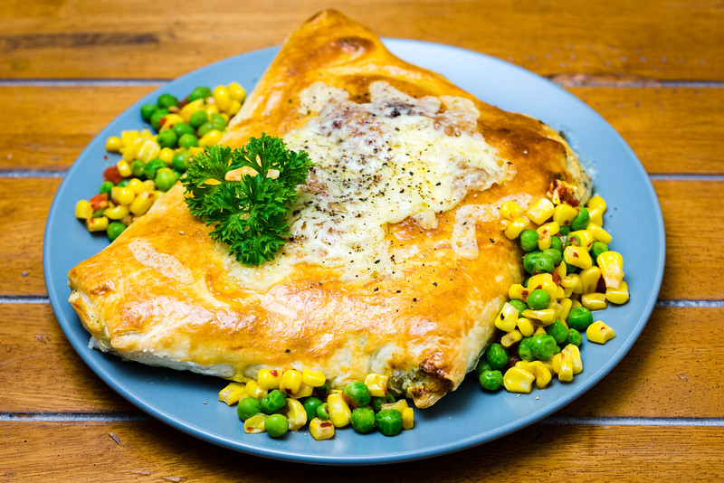 Baked salmon in pastry with vegetables