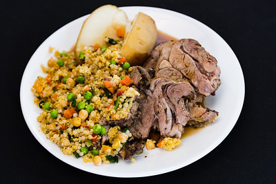 Roast lamb shoulder with potato and pearl barley couscous