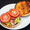 Bacon, tomato, avocado and cheese sandwich