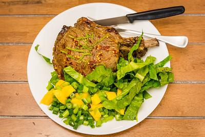 Rib eye fillet steak with mango salad