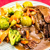 Slowly cooked beef with vegetables and gravy