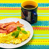 Scrambled eggs and streaky bacon