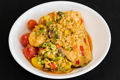 Salmon with curry prawns with couscous and quinoa