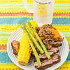 Roast lamb with quinoa, pumpkin, sweet corn and asparagus