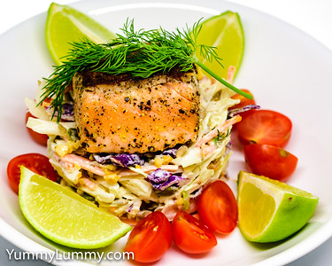 Pan-fried salmon on a coleslaw stack