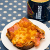 Bacon and cheese sandwich with coffee