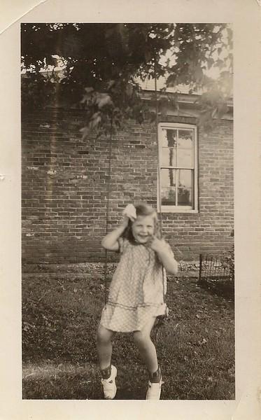 Elizabeth in front of the garage that grandpa built