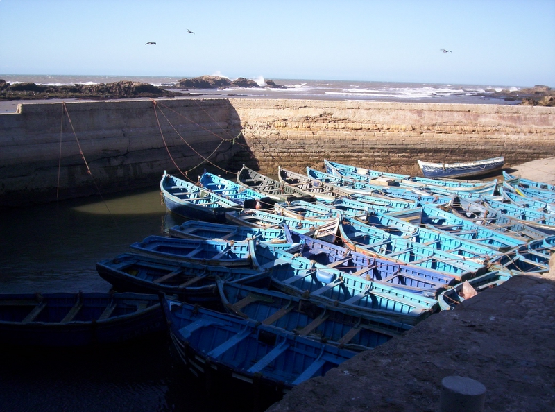 Industry-standard photo of blue boats near the daily fish market in Essaouira, Morocco; Nov. 2005