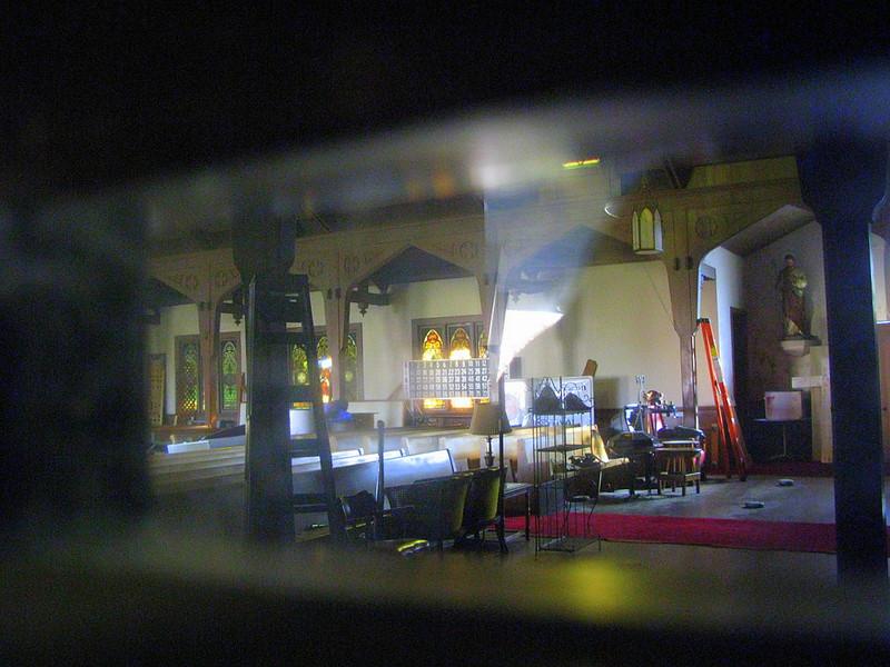 Saint Rose church, Santa Rosa, under repair, seen through part of cross-shaped window