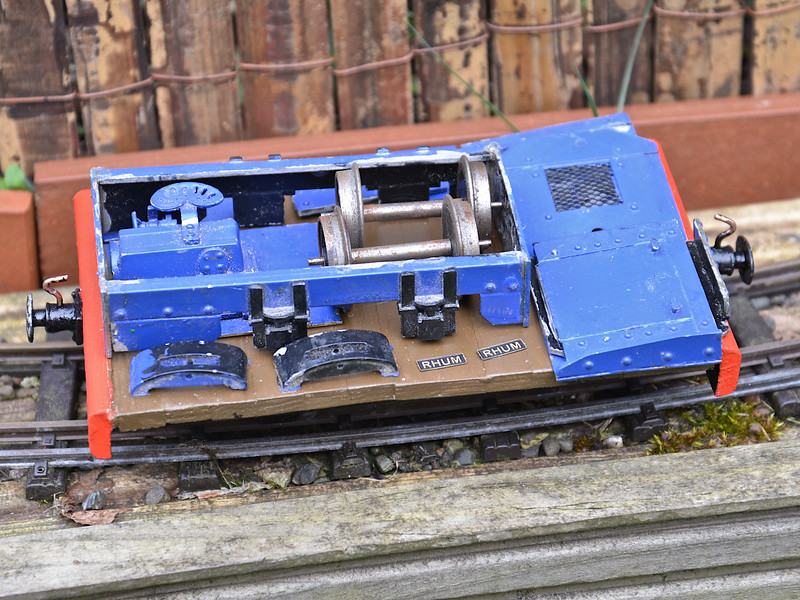 A scratch-built wagon carrying parts for a loco under restoration.