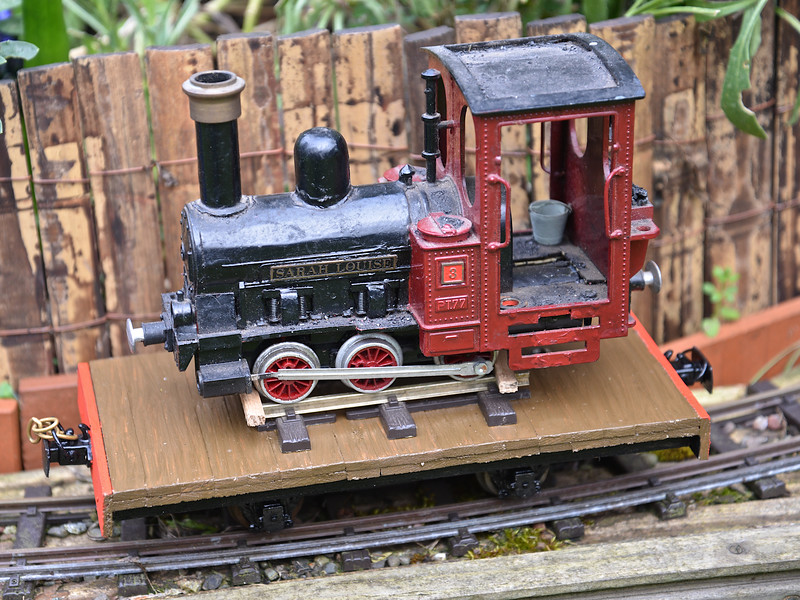 A scratch-built wagon carrying a restored loco.
