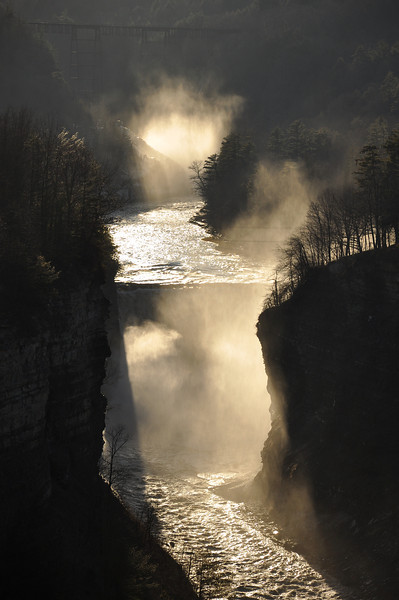Letchworth middle and upper falls mist near sunset.