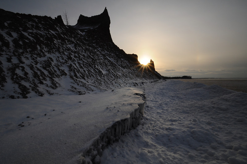 Chimney Bluffs icy sunset.