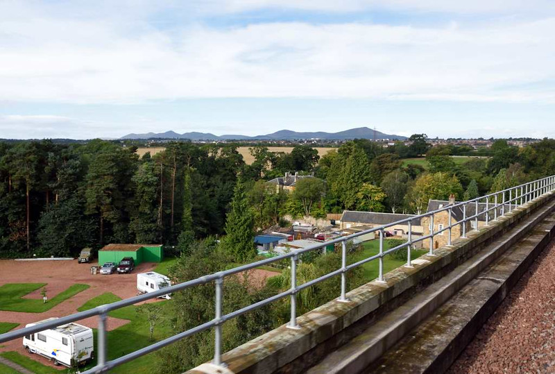 Crossing Newbattle viaduct, Sun 25 September 2016 - 1007.  Looking west to the Pentland hills.  The viaduct is 1200 feet long and has 23 arches.  Fortunately it is listed Grade B.  Had it been demolished, it is unlikely that the Borders Railway would have reopened.