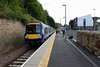 Galashiels station, Sun 25 September 2016 1 - 1150.  Looking south towards Tweedbank with 170434 working ScotRail's 2T67 1145 Tweedbank - Edinburgh.  At right is the new rail / bus interchange, opened in August 2015.  The old Galashiels station had four platforms, and there was a goods yard and loco shed.  The site has been redeveloped and as can be seen space for the Borders Railway is at a premium.