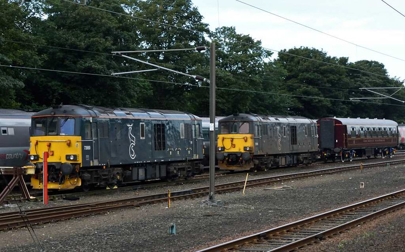 73969 (nearer) & 73966, Craigentinny, Sun 25 September 2016 - 0955.  The GB Railfreight locos rest between Caledonian Sleeper duties with the Royal Scotsman spa car behind them.