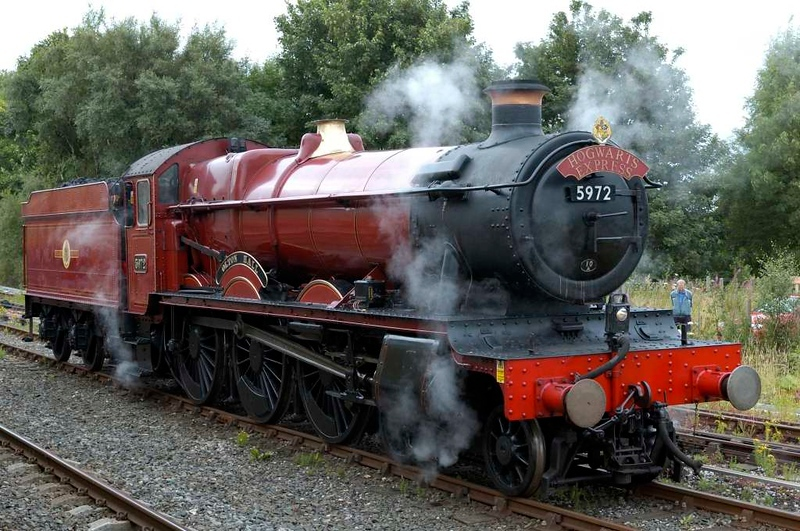5972 Olton Hall, Hellifield, Sat 30 July 2005  - 1031.  The Hall had run light from Steamtown. Note the Hogwarts Express headboard.