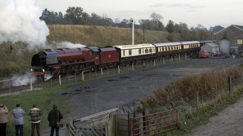 46229 Duchess of Hamilton, Appleby, Sat 29 October 1983 1.  There were two run-pasts at Appleby; here are four photos.  This one shows 46229 setting back from the station after passengers had disembarked.