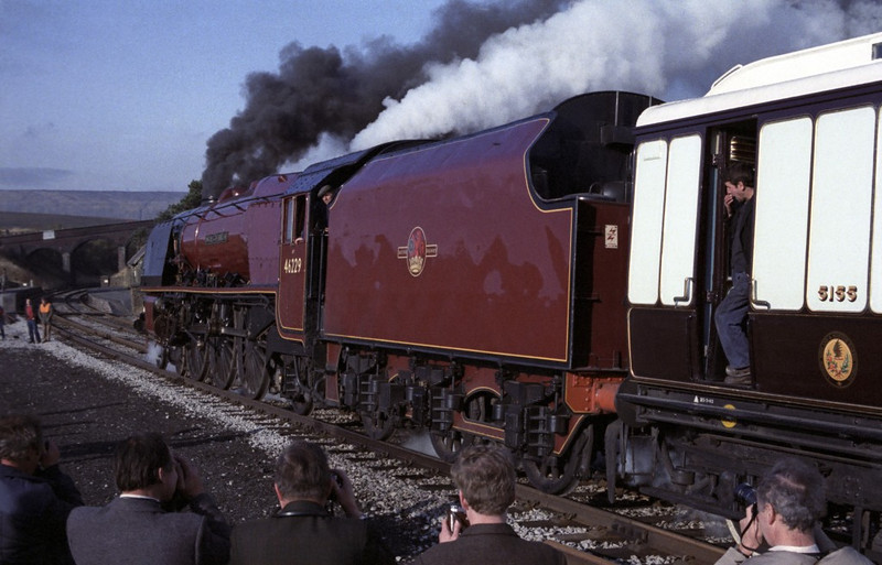 46229 Duchess of Hamilton, Dent, Sat 29 October 1983 1.  There was a photo stop at Dent: here are eight photos.  The Duchess's support coach is LMS 5155.  Originally a brake corridor first built by the LNWR at Wolverton in 1905, it was modified by the LMS in 1925 and used in the royal train.