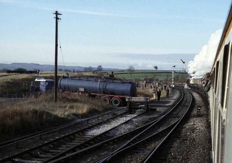 46229 Duchess of Hamilton, leaving Hellifield, Sat 29 October 1983.   NB the water bowser.