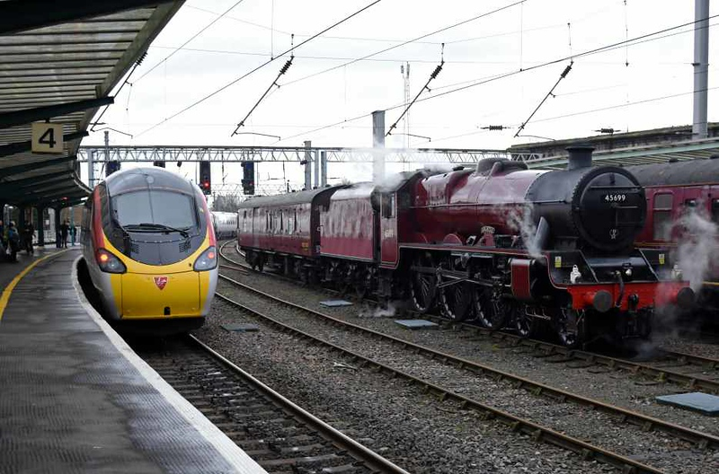 390011 City of Lichfield (1M12) & 45699 Galatea (5Z87), Carlisle, Sat 27 January 2018 - 1252.  Virgin's 1140 Glasgow - Euston departs as Galatea waits to propel its support coach to Upperby and London Road Junction to take water and turn.  The CME stock was left in platform 3 during its time at Carlsile.