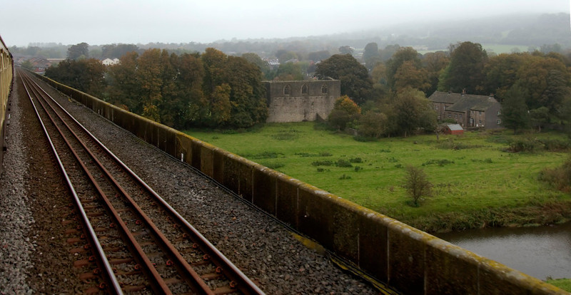 Crossing Whalley Arches, 10 October 2009 - 1043 1     Looking east from the longest railway viaduct in Lancashire (48 arches, 2000 feet) as it crosses the valley of the Lancashire Calder.  The remains of the 14th century Whalley Abbey (Cistercian) are right of centre.