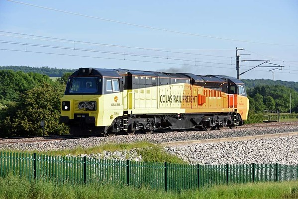 70811, 0Z71, Carnforth, Wed 6 June 2018 - 1835.  The Colas machine sets off for Carlisle to work the next day's Scarborough Spa Express.  It had refuelled at Steamtown after arriving from Bescot (dep 1411.)  The SSE headboard is already in place.