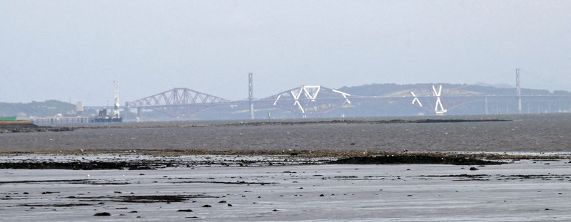 Forth road and rail bridges, Fri 18 June 2010 - 1457      From Longannet 'The Highlander' ran along the north shore of the Firth of Forth to Dunfermline.  Parts of the rail bridge are wrapped in shrouding, hence its strange appearance.