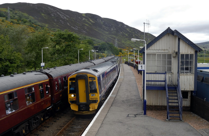 158720 & 158xxx, Helmsdale, Sun 20 June 2010 -1332 1    First ScotRail's 1153 Wick - Thurso - Inverness crosses 'The Highlander.'