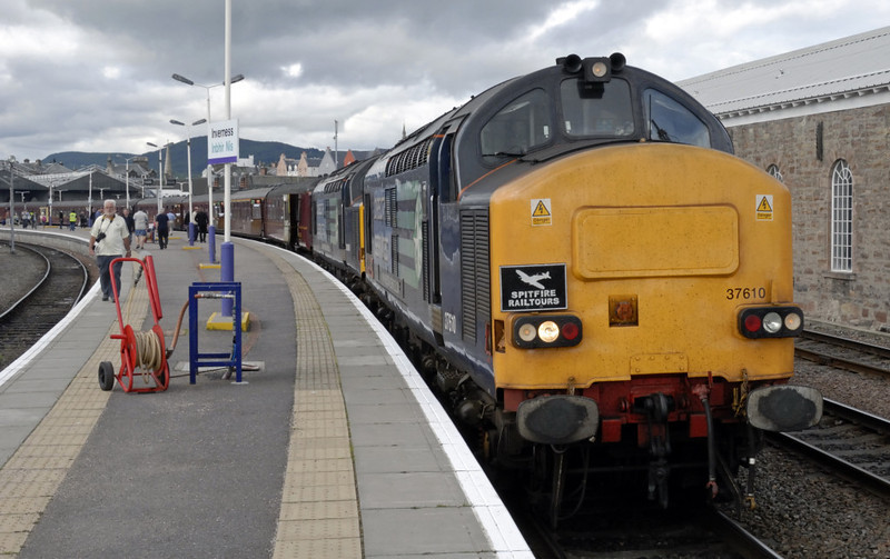 37610 T S (Ted) Cassady & 37608, 1Z41, Inverness, Mon 21 June 2010 1 - 0949      The 37s await departure from platform 2 at 1010 with the final day's run of 'The Highlander' back to Birmingham International via Druimuachdar summit and the Forth Bridge.  The Inverness & Nairn shed building is at right.