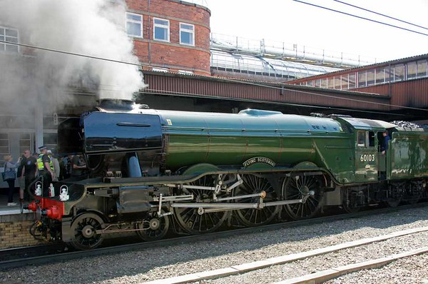 60103 Flying Scotsman, 1Z63, York, Sun 17 July 2016 - 1111.  60103 awaits departure at 1143 with The Waverley to Carlisle.  The train had been brought from Leeds by 57601 + 57313, which had handed over to 60103 at platform 9 and not Holgate sidings as expected.  Mass trespass on previous runs by Flying Scotsman led to a strong presence by British Transport Police, including officers on the train.  But the Network Rail helicopter, which had scouted previous trips for advance warning of problems, was not deployed.  Flying Scotsman's performance with the previous Waverley had enabled the load to be increased from 11 to 12 coaches: 99953 (NRM support coach), 99723, 4994, 1984, 5035, 1861, 5229, 99348 Topaz, 99347, 1961 & 99125.  There was no diesel.