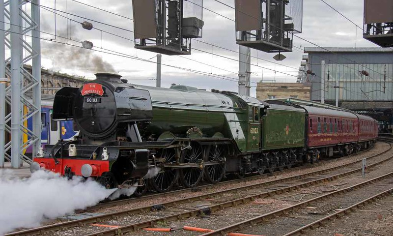 60103 Flying Scotsman, 5Z64, Carlisle, Sun 17 July 2016 2 - 1749.  60103 had left The Waverley stock at platform 3.  When Scotsman returned after turning, it fouled the signal so had to set the train back as seen here.  Note that the headboard had been changed.
