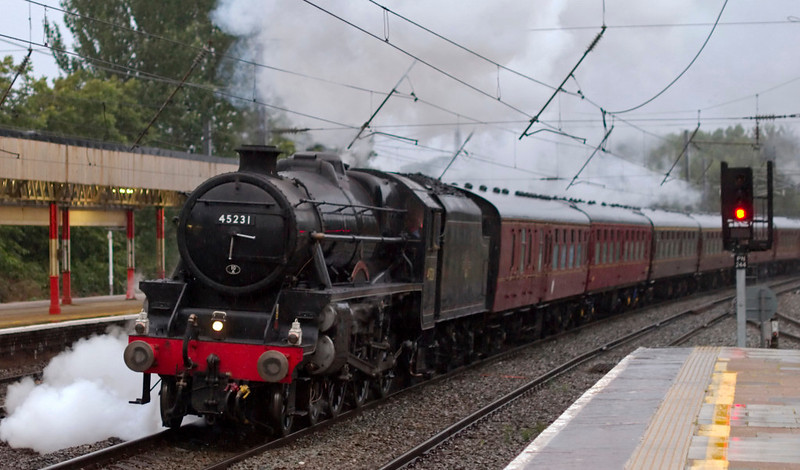 45231 The Sherwood Forester, 5Z43, Lancaster, 26 August 2009 - 0651 1.   In pouring rain, the Black 5 charges Ripley bank (1 in 98) with the 'Welsh Mountaineer' ECS from Carnforth...