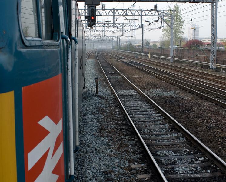 47853 Rail Express, 1Z41, Crewe, 14 April 2007 - 0712.  Waiting at signal CE 144.