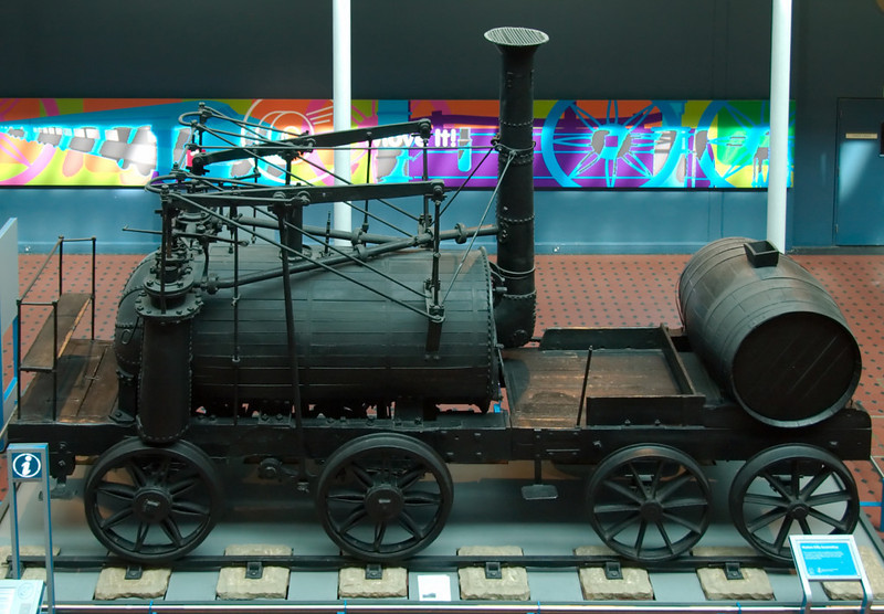 Wylam Dilly, National Museum of Scotland, Edinburgh, 3 May 2008 1    Built by William Hedley in 1815, Dilly is preserved in the Royal Museum in Edinburgh (now part of the National Museum of Scotland).  It is kin to Hedley's better known and earlier Puffing Billy, preserved in the Science Museum, South Kensington.  NB that the rails are mounted on stone blocks.