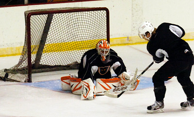 Goalie Scott Munroe blocked a shot by Erik Gustafsson during practice on the first day of practice for the Adirondack Phantoms at the Glens Falls Civic Center. Photo Erica Miller 10/9/12 spt_Munroe_Thurs