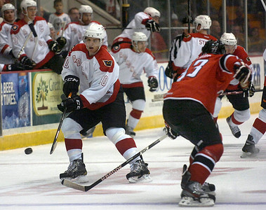 Assigned to Adirondack because of the NHL lockout, Philadelphia Flyer Brayden Schenn passes the puck during Adirondack's home-opener as the Phantoms faced the Portland Pirates at the Glens Falls Civic Center. Ed Burke 10/13/12