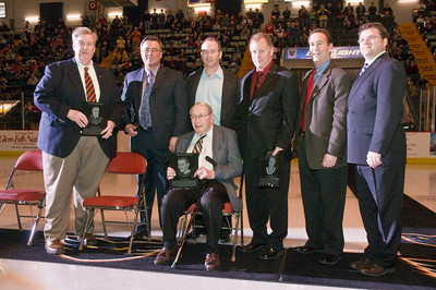 Bill Birch, Greg Joley, Peter Dureen, Glen Mertosky, Mike Thomson, Dave Demarko and Bill Dureen (sitting) pose for the camera during the induction ceremony Saturday night for the Adirondack Hockey Hall of Fame. Photo Eric Jenks 3/13/10 For the Saratogian