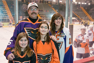 Sarah Elizabeth and Katherine Shewman pose with their father Richard (Back Center) Saturday Night at the Glens Falls Civic Center before the Phantoms game.. This was one of over 40 games that the Shewman's have gone to this year. Photo Eric Jenks 3/13/10 For the Saratogian.