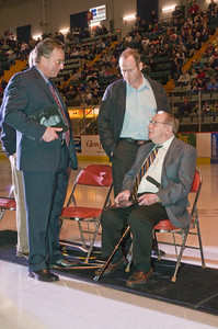 Greg Joley has a chat with fellow inductee Bill Dureen while Peter Dureen listens during the induction Ceremony for the Adirondack Hockey Hall of Fame Saturday night. Photo Eric Jenks 3/13/10