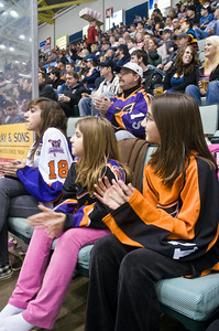 Sarah Elizabeth and Katherine Shewman watch the phantoms game with their father Richard (Back Center) Saturday Night at the Glens Falls Civic Center. This was one of over 40 games that the Shewman's have gone to this year. Photo Eric Jenks 3/13/10 For the Saratogian.