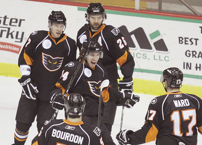 Adirondack Phantoms converge on teammate Andreas Nodl, center, after his first period goal over the Syracuse Crunch during Wednesday's AHL game in Glens Falls. Ed Burke 2/24/10